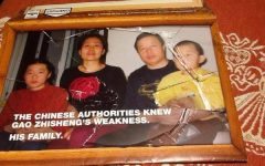A picture of the Gao family is cased in a broken frame. The Gao family was once together until Peter Gao, Geng He and Grace Gao moved to America in 2009. Used with permission