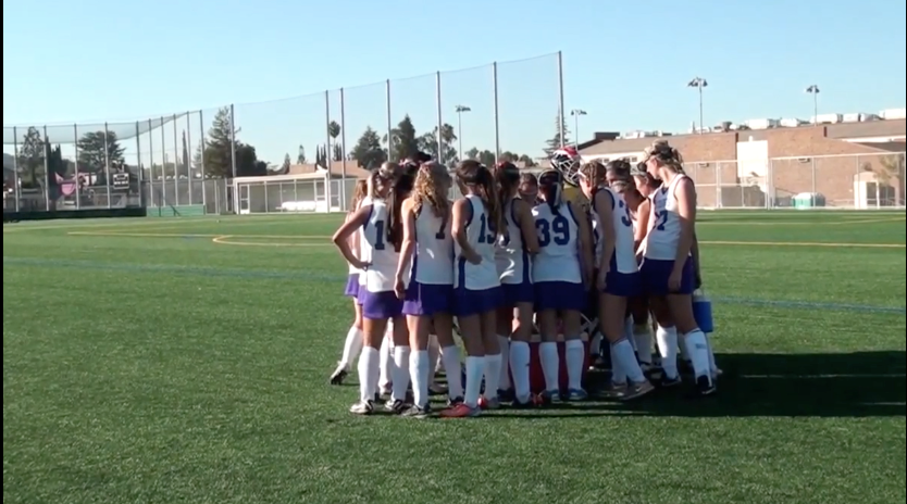 MVHS Field Hockey team huddles at halftime to regroup and discuss their performance during the previous half.