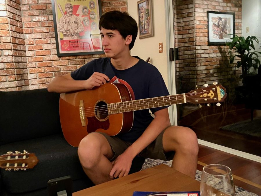 Junior+Jacob+Vrabel+began+learning+to+play+the+guitar+over+the+summer+with+help+from+his+parents%2C+as+his+dad+has+played+guitar+for+15+years%2C+and+his+mom+has+played+since+she+was+young.