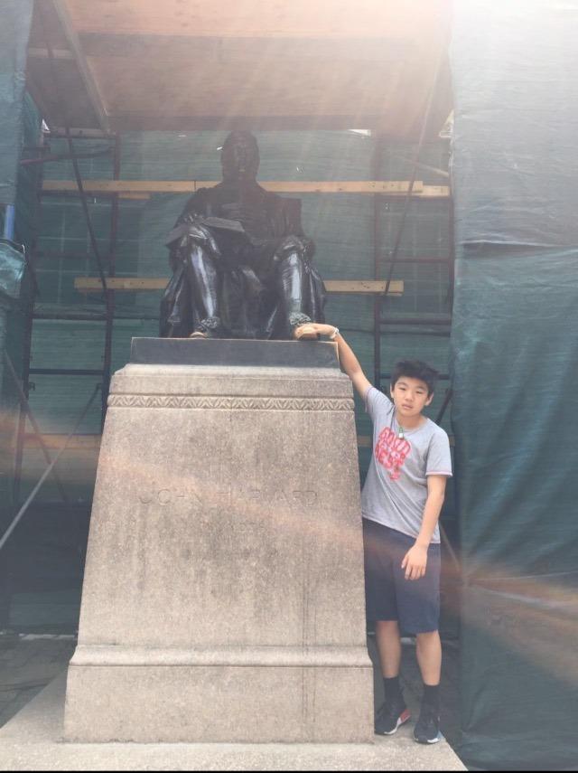Touching John Harvard's shoe on a field trip in middle school.