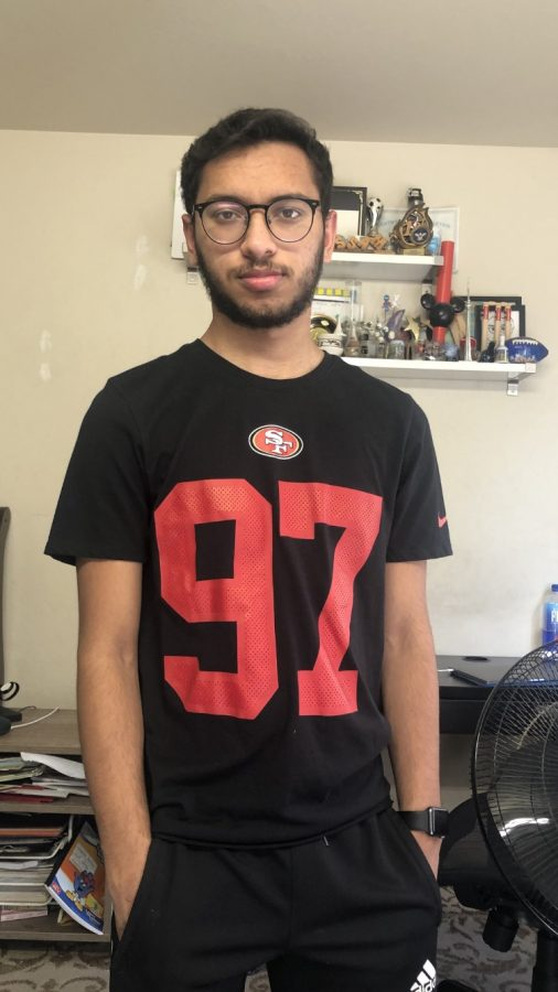 Senior Bassam Malik poses with his San Francisco 49ers jersey featuring defensive end Nick Bosa's number.