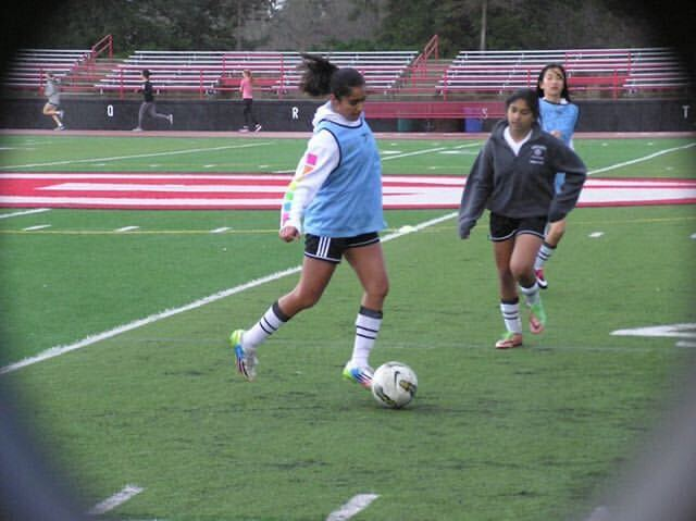 Junior Anika Mishra practices before a game with a small crowd. Photo used with permission by Mishra.