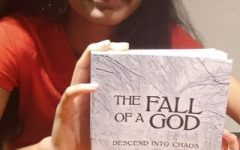 Janya Bhaskar poses with a copy of her debut novel