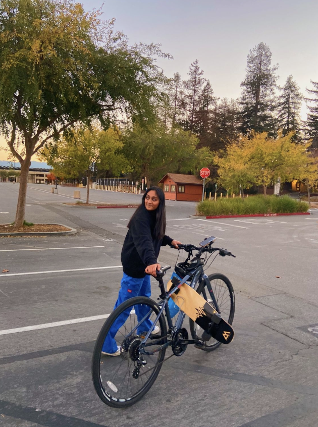 Dwivedi walks with her bike in the De Anza College parking lot after spending the day biking with friends. (Photo used with permission from Navarin Pirachai)