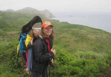 Frazier carries her son on her back as she hikes in Point Reyes, around 30 miles from San Francisco | Photo courtesy of Deborah Frazier