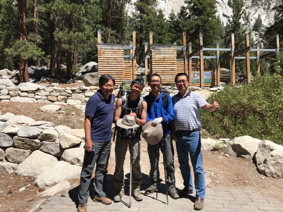 Seniors Daniel Kao and Richard Liu take a photo with their parents after finishing the John Muir Trail.