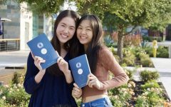 Lu and Zhou pose with their paperback versions of