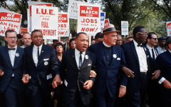 MLK links arms with protestors at the March on Washington for Jobs and Freedom, 1963