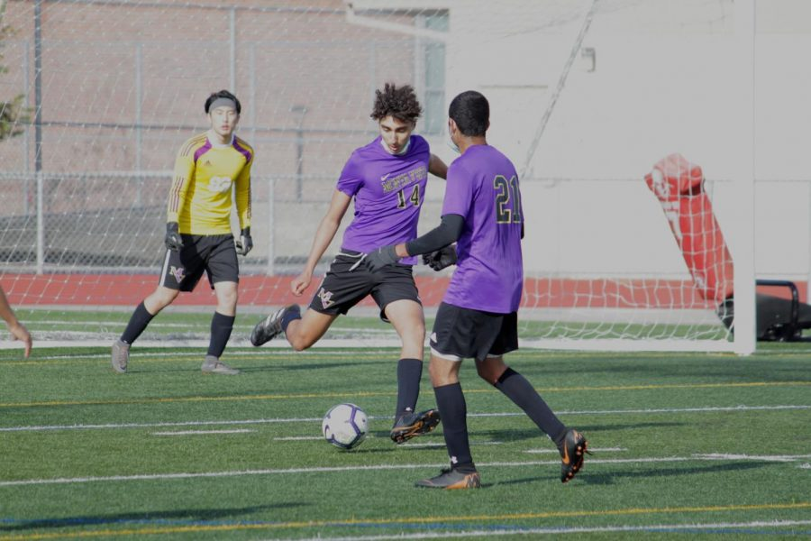 Junior Shervin Jalilvand passes a long ball into the midfield.