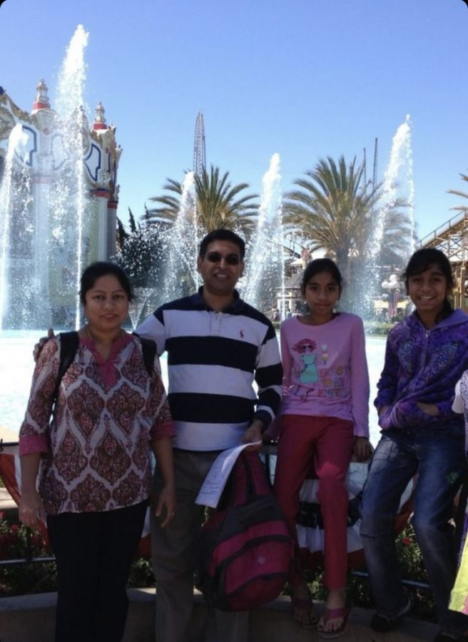 Sundar family poses for a photo at an amusement park
