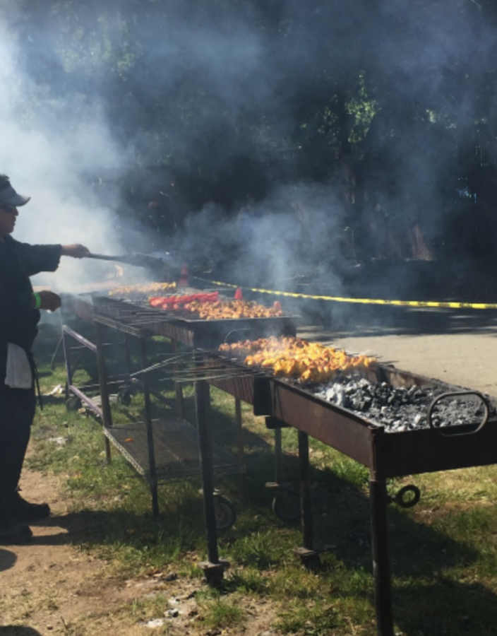 Kabobs are prepared to be sold at the food kiosks in Vasona Park