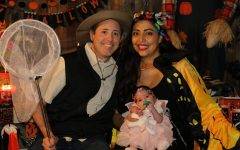 Victorine poses with his family on Halloween