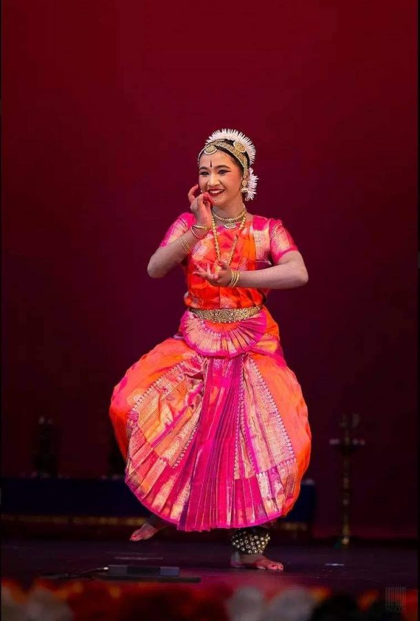 Senior Harshitha Pandian dances during her arangetram in 2017. Photo courtesy of Harshitha Pandian | Used with Permission