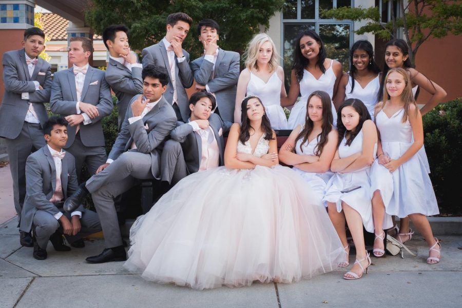 Junior Hannah Baker poses with her quinceañera court.