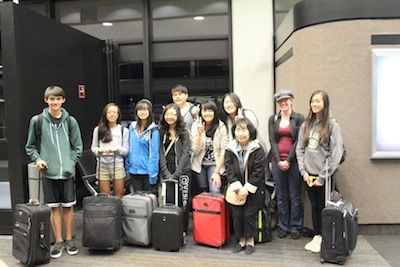 Japanese teacher Keiko Howard and the level two, three and four teams wait for their flight to Washington D.C in April 2013. Photo used with permission of Julia Liu.
