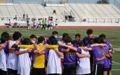 Varsity Boys Soccer players share a team huddle following a game.