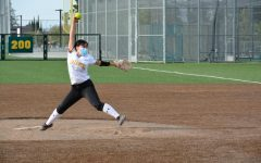 Freshman Catherine Yao pitches a curveball during the sixth inning. Photo by Nika Zamani