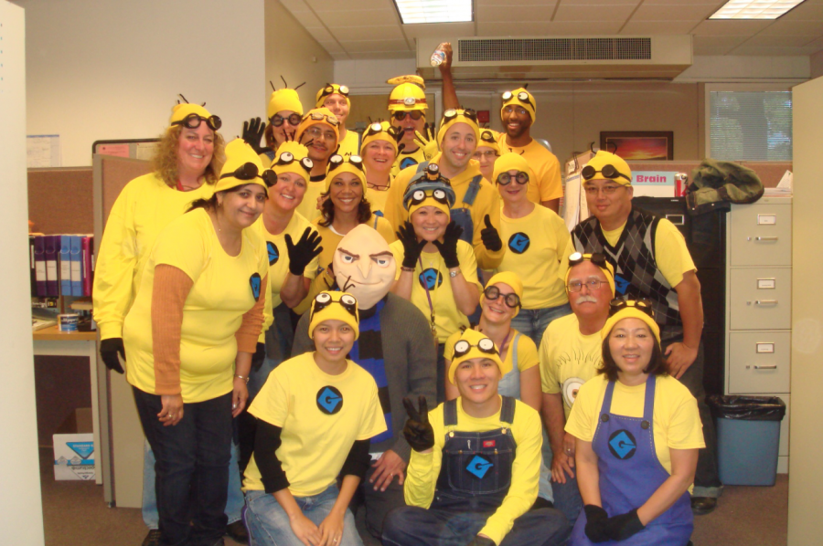 Sheila Altmann and other staff members dress as minions for Halloween.   Photo courtesy of Clay Stiver // Used with permission