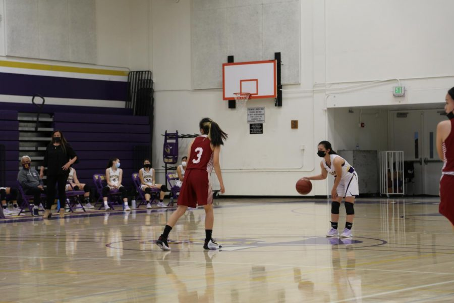Kelli Kosakura dribbes the ball before an opponent after the MVHS team gained posession.