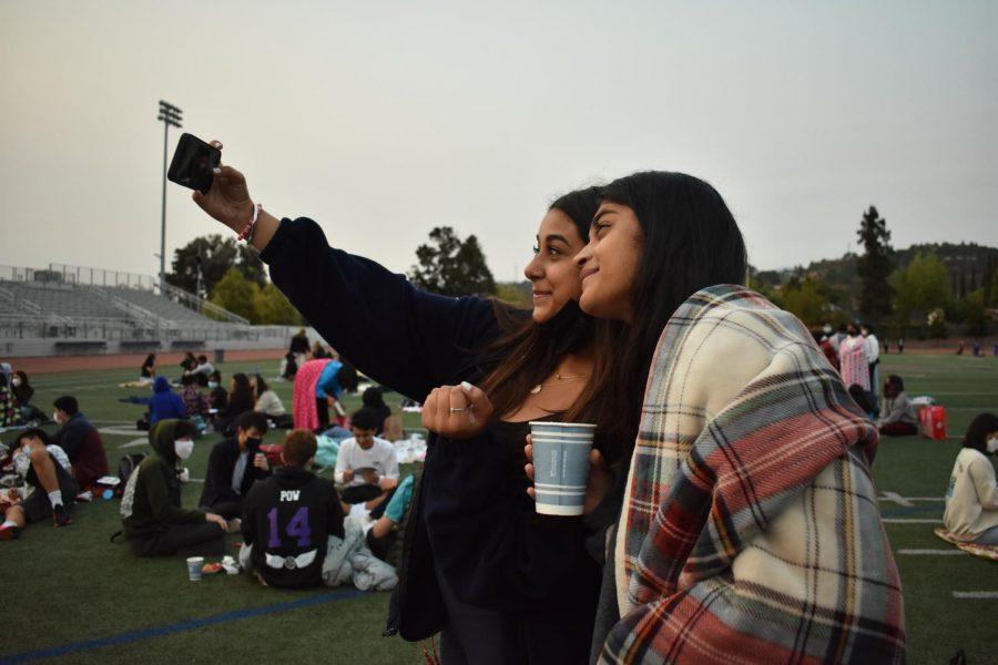 Seniors Diya Bahl and Anika Somasundaram take a selfie to capture their memories at the event.