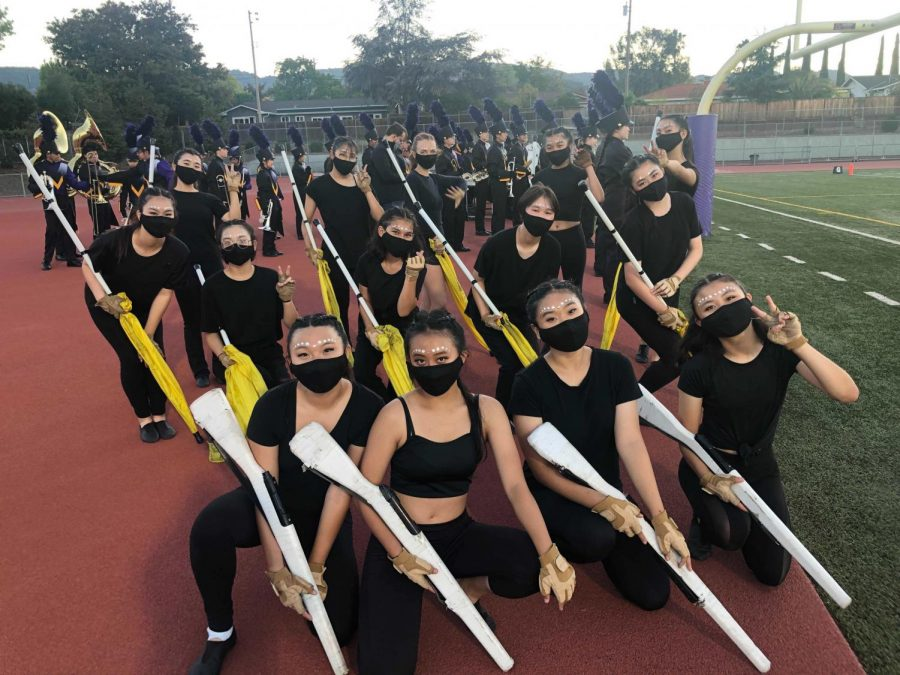 Members of the Color Guard pose for a photo before their performance in the first football game of the season.