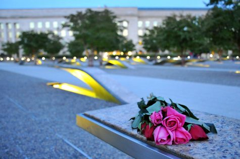 A bouquet of roses were placed in the U.S. Coast Guard Headquarters to commemorate the lives lost during 9/11. Photo by Patrick Kelley