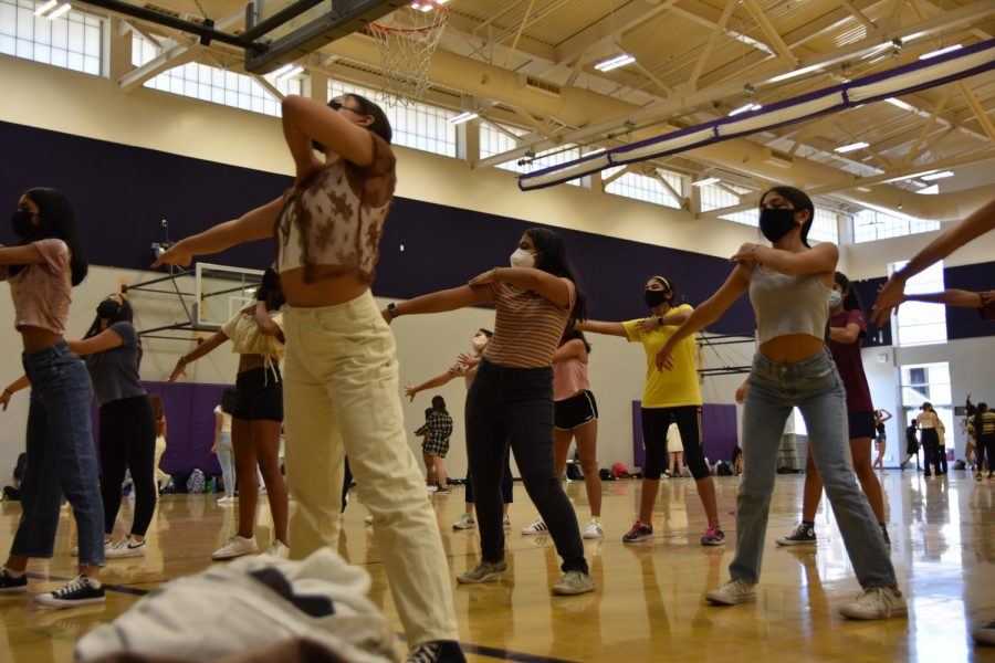 Sophomore girls go over a specific part of the choreography together   Photo by Priscilla Cho