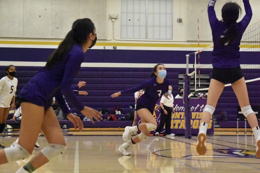 Senior Marissa Jensen prepares to leap into the air to receive a pass from her teammate.