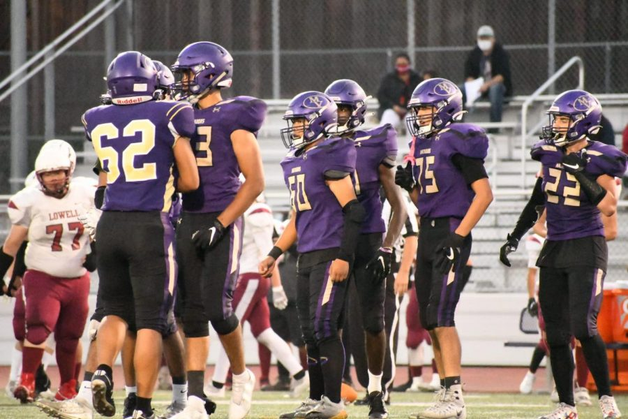 MVHS players huddle together following a play