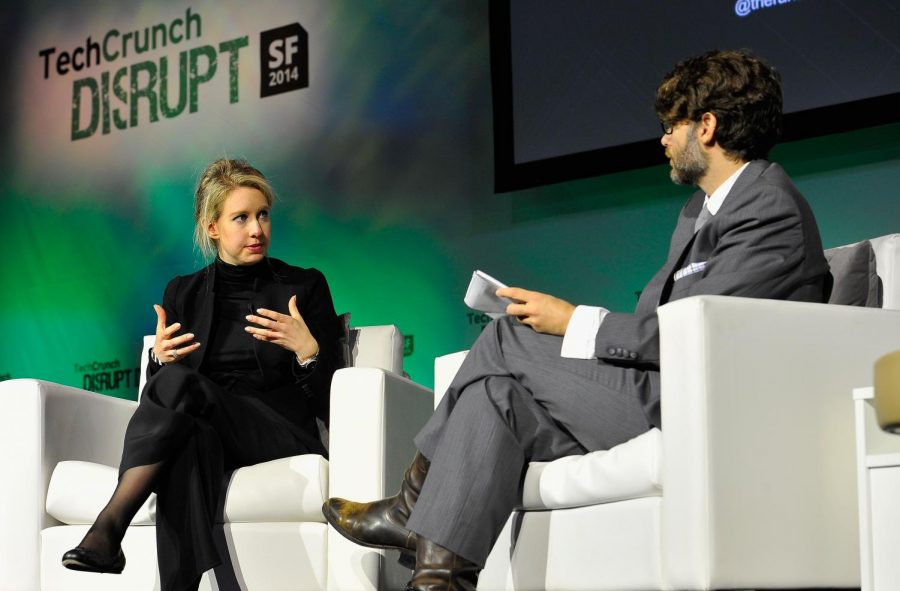 Elizabeth Holmes (left) talks with an interviewer about her company