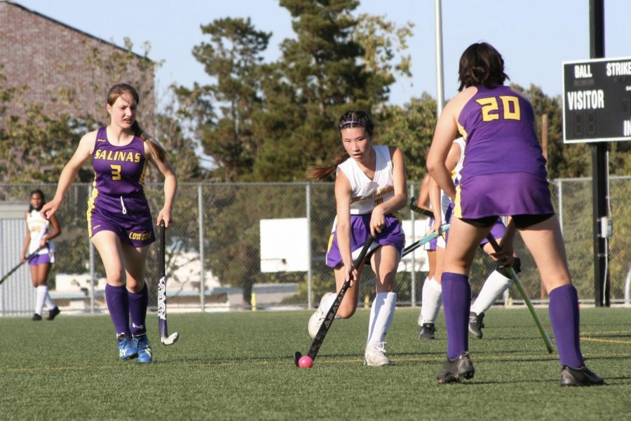 Senior Carolyn Huang dodges around opponents from Salinas High School.