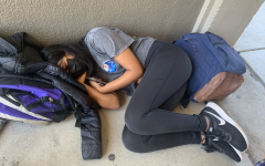 Junior Aria Agarwal takes a nap on the floor during lunch break after getting 5 hours of sleep the night before.