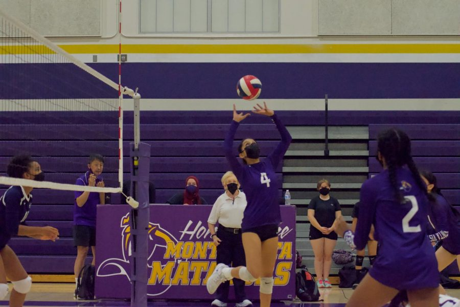 Shanware sets the ball in the last play of the final set. MVHS would win, with the final score 15-13. Photo by Lance Tong