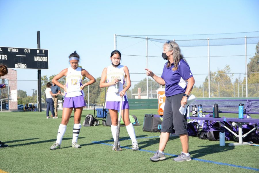 Coach Eachus encourages the team during halftime.