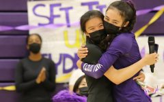 Junior Sydney Su and senior Marissa Jensen embrace in a tight hug. The four seniors were given speeches and gifts from the juniors before the start of the game.
