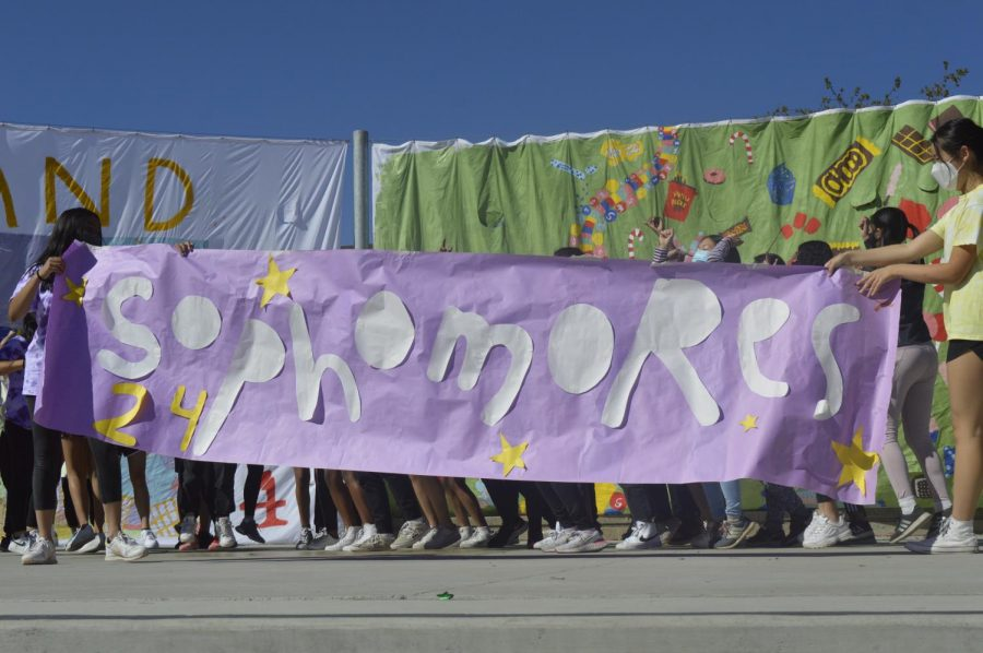 Performers hold up the sophomore banner after finishing their skit. Photo by Justin Kim