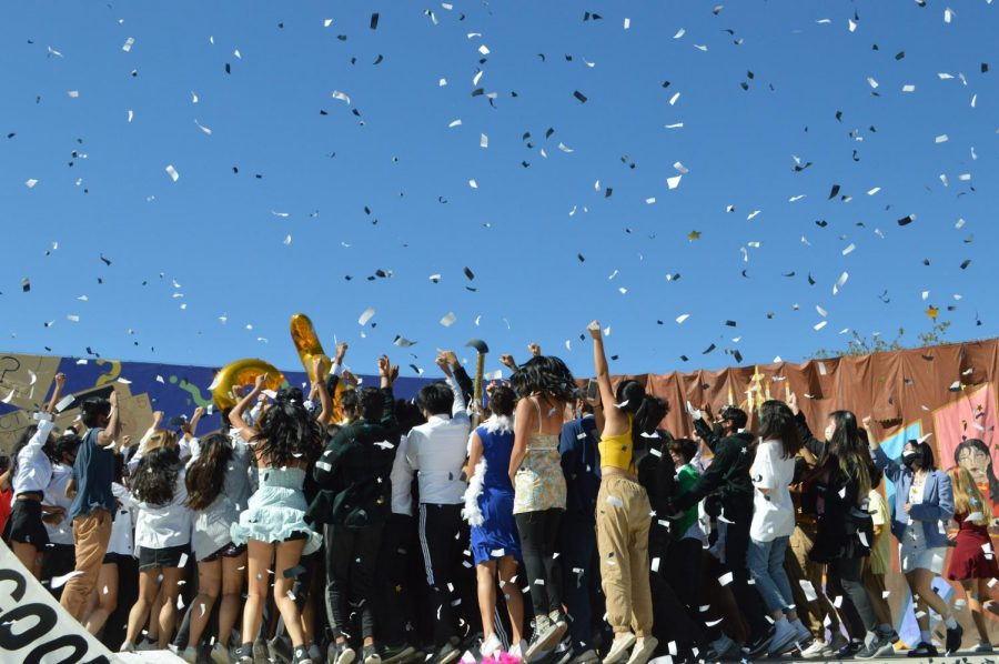 The Class of 2022 cheers in a huddle following the end of their homecoming skit performance for the finale time. Following months of preparation making costumes, props, skit decs and learning choreography, they got the chance to finally show their spirit in front of a crowd of MVHS students and faculty. Photo by Aditya Shukla