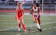 Senior Tanisha Pulla tries to maintain possession as a SHS opponent attempts to steal the ball.